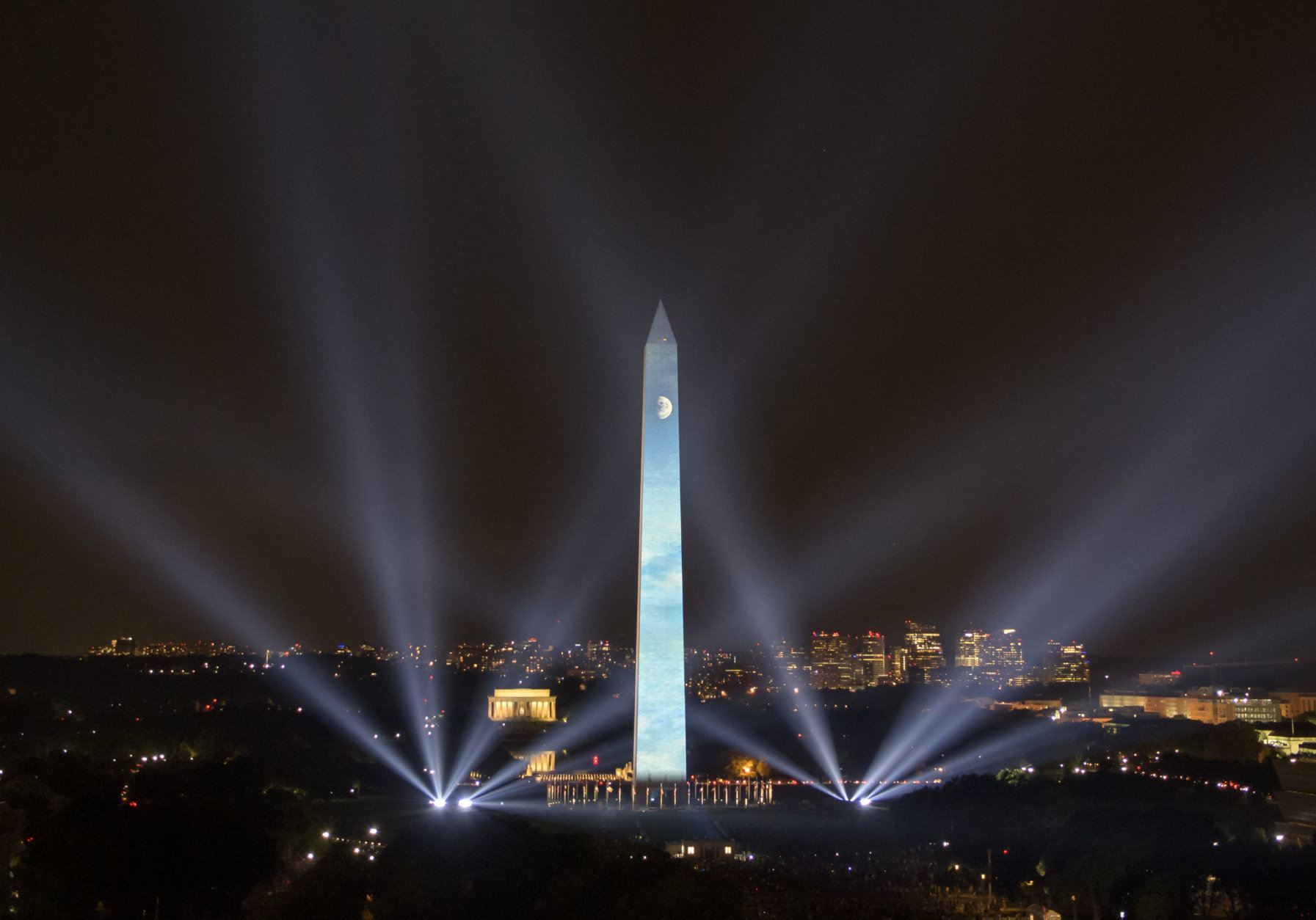 """In this photo provided by NASA, the 50th anniversary of the Apollo 11 mission is celebrated in a 17-minute show, """"Apollo 50: Go for the Moon"""" which combined full-motion projection-mapping artwork on the Washington Monument and archival footage to recreate the launch of Apollo 11 and tell the story of the first moon landing, Friday, July 19, 2019, in Washington. (NASA/Bill Ingalls via AP)"""
