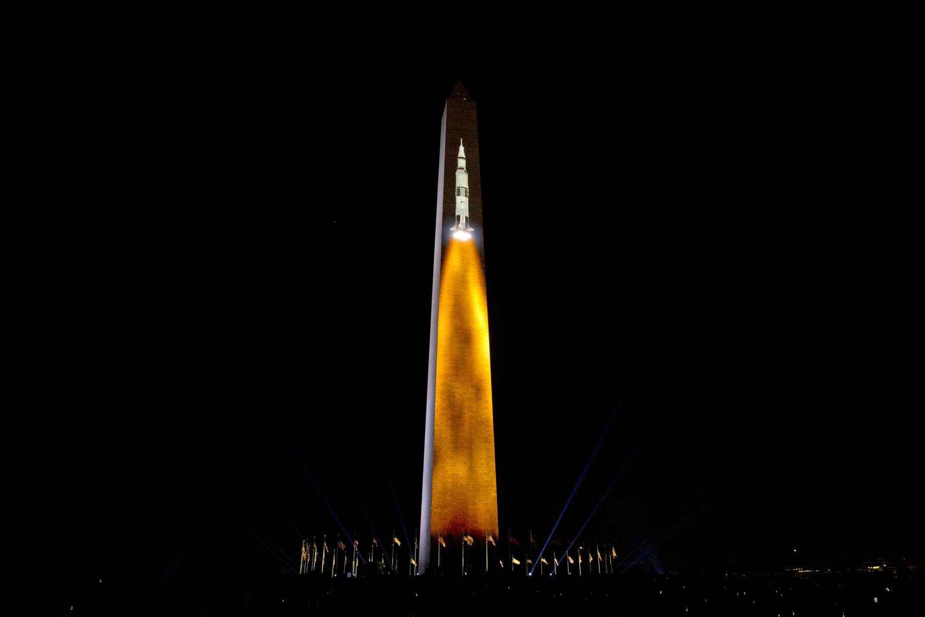An image of a 363-foot Saturn V rocket used in the Apollo 11 mission, blasting off, is projected on the Washington Monument, during the 50th anniversary of the Apollo moon landing festivities at the National Mall in Washington, Friday, July 19, 2019. (AP Photo/Jose Luis Magana)