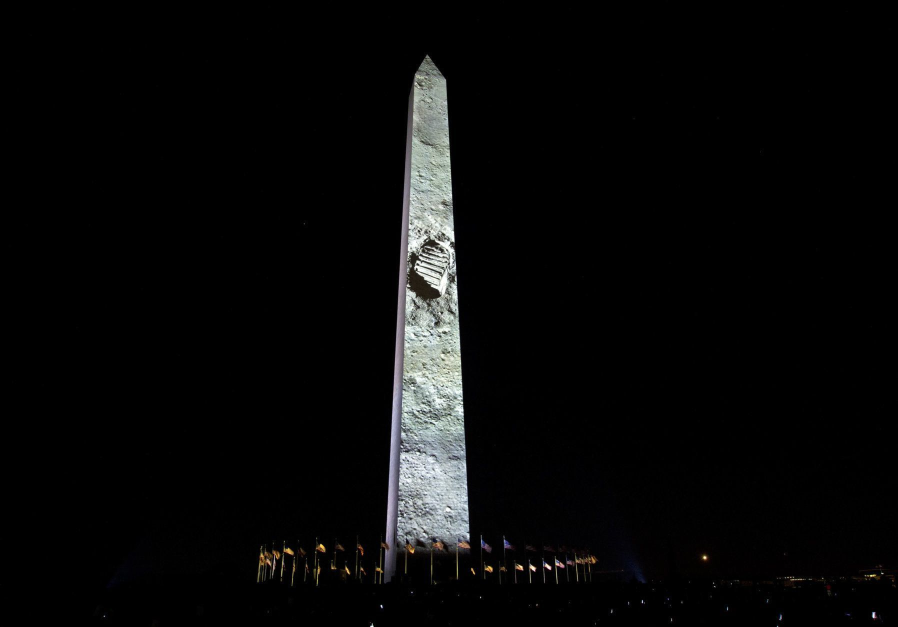 Neil Armstrong foot print on the rocky Moon is projected on the Washington Monument, during the 50th anniversary of the Apollo moon landing festivities at the National Mall in Washington, Friday, July 19, 2019. (AP Photo/Jose Luis Magana)