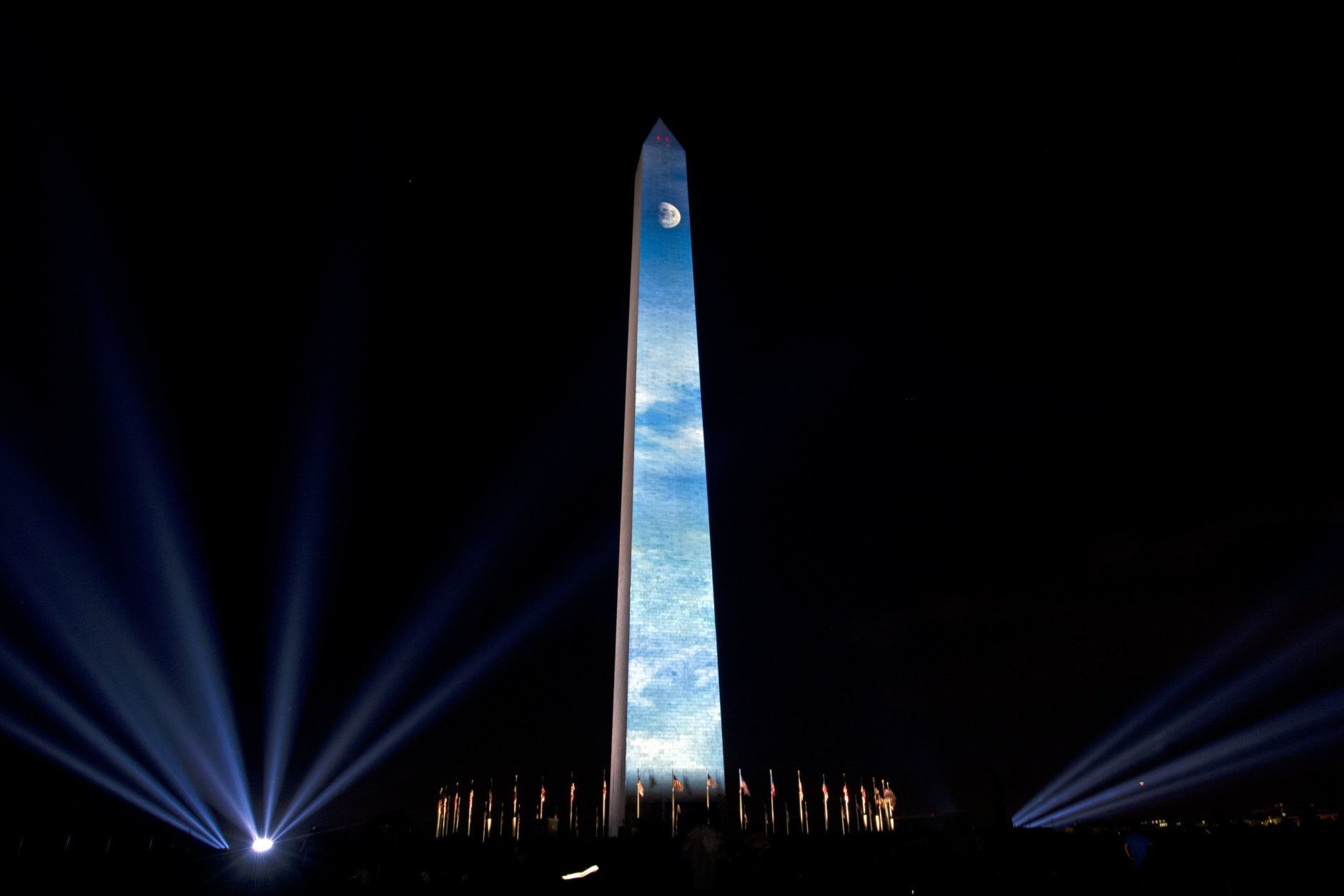 The Moon is projected on the Washington Monument, during the 50th anniversary of the Apollo moon landing festivities at the National Mall in Washington, Friday, July 19, 2019. (AP Photo/Jose Luis Magana)