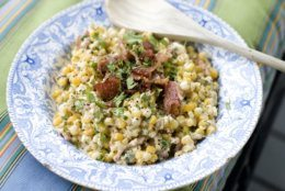 This July 29, 2013 photo shows grilled Mexican street corn salad in Concord, N.H. (AP Photo/Matthew Mead)