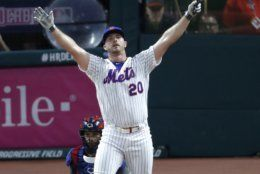Pete Alonso, of the New York Mets, celebrates winning the Major League Baseball Home Run Derby, Monday, July 8, 2019, in Cleveland. The MLB baseball All-Star Game will be played Tuesday. (AP Photo/Ron Schwane)