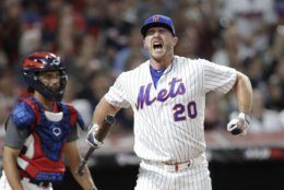 Pete Alonso, of the New York Mets, reacts during the Major League Baseball Home Run Derby, Monday, July 8, 2019, in Cleveland. The MLB baseball All-Star Game will be played Tuesday. (AP Photo/Tony Dejak)