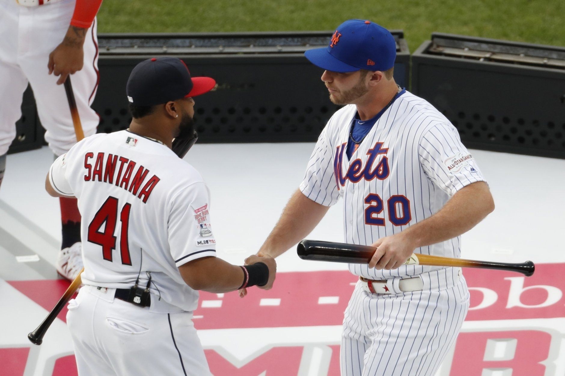 Carlos Santana, of the Cleveland Indians, and Pete Alonso, of the New York Mets, are introduced during the Major League Baseball Home Run Derby, Monday, July 8, 2019, in Cleveland. The MLB baseball All-Star Game will be played Tuesday. (AP Photo/Ron Schwane)