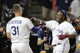 Vladimir Guerrero Jr., right, of theToronto Blue Jays, is congratulated by Joc Pederson, of the Los Angeles Dodgers, during the Major League Baseball Home Run Derby, Monday, July 8, 2019, in Cleveland. The MLB baseball All-Star Game will be played Tuesday. (AP Photo/Tony Dejak)