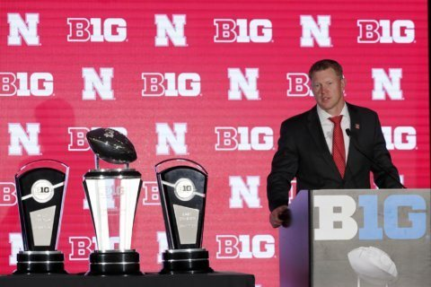 The Latest: Ohio St DE emulates legendary coach in referring to 'team up north'