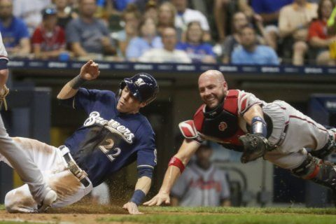 Yelich hits grand slam, Brewers power past Braves, 13-1