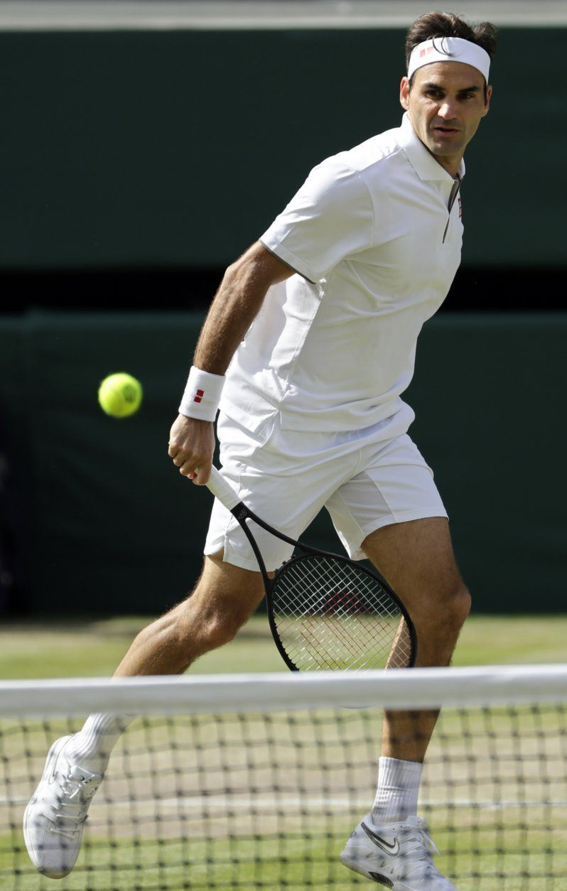Switzerland's Roger Federer plays a shot to Serbia's Novak Djokovic during the men's singles final match of the Wimbledon Tennis Championships in London, Sunday, July 14, 2019. (AP Photo/Ben Curtis)