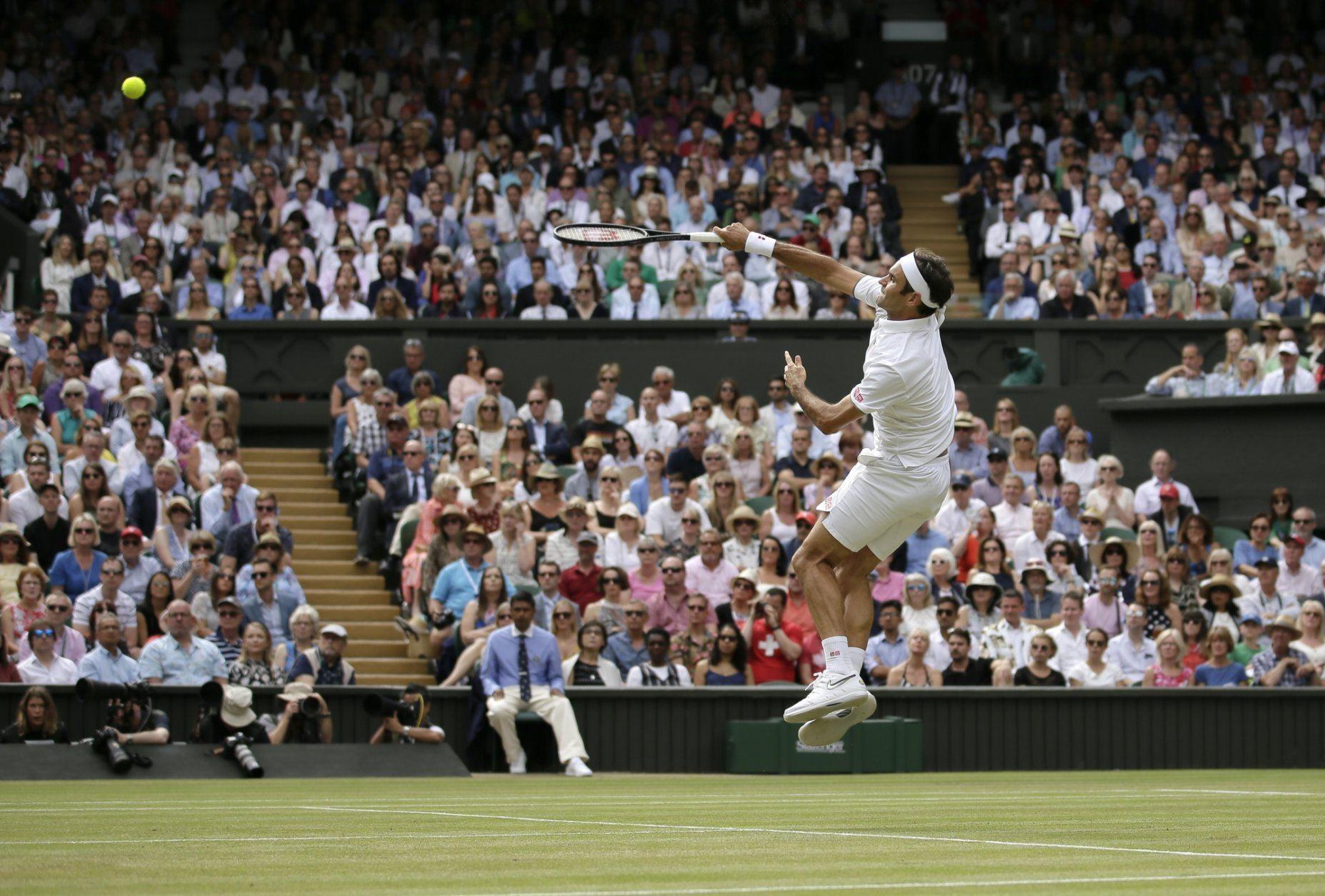 Switzerland's Roger Federer returns the ball to Serbia's Novak Djokovic during the men's singles final match of the Wimbledon Tennis Championships in London, Sunday, July 14, 2019. (AP Photo/Tim Ireland)