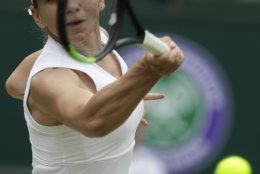 Romania's Simona Halep returns the ball to United States' Serena Williams during the women's singles final match on day twelve of the Wimbledon Tennis Championships in London, Saturday, July 13, 2019. (AP Photo/Kirsty Wigglesworth)