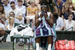 United States' Serena Williams wipes her face during the women's singles final match against Romania's Simona Halep on day twelve of the Wimbledon Tennis Championships in London, Saturday, July 13, 2019.(AP Photo/Kirsty Wigglesworth)