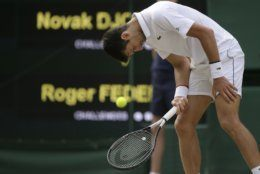 Serbia's Novak Djokovic is dejected after losing a point to Switzerland's Roger Federer during the men's singles final match of the Wimbledon Tennis Championships in London, Sunday, July 14, 2019. (AP Photo/Tim Ireland)