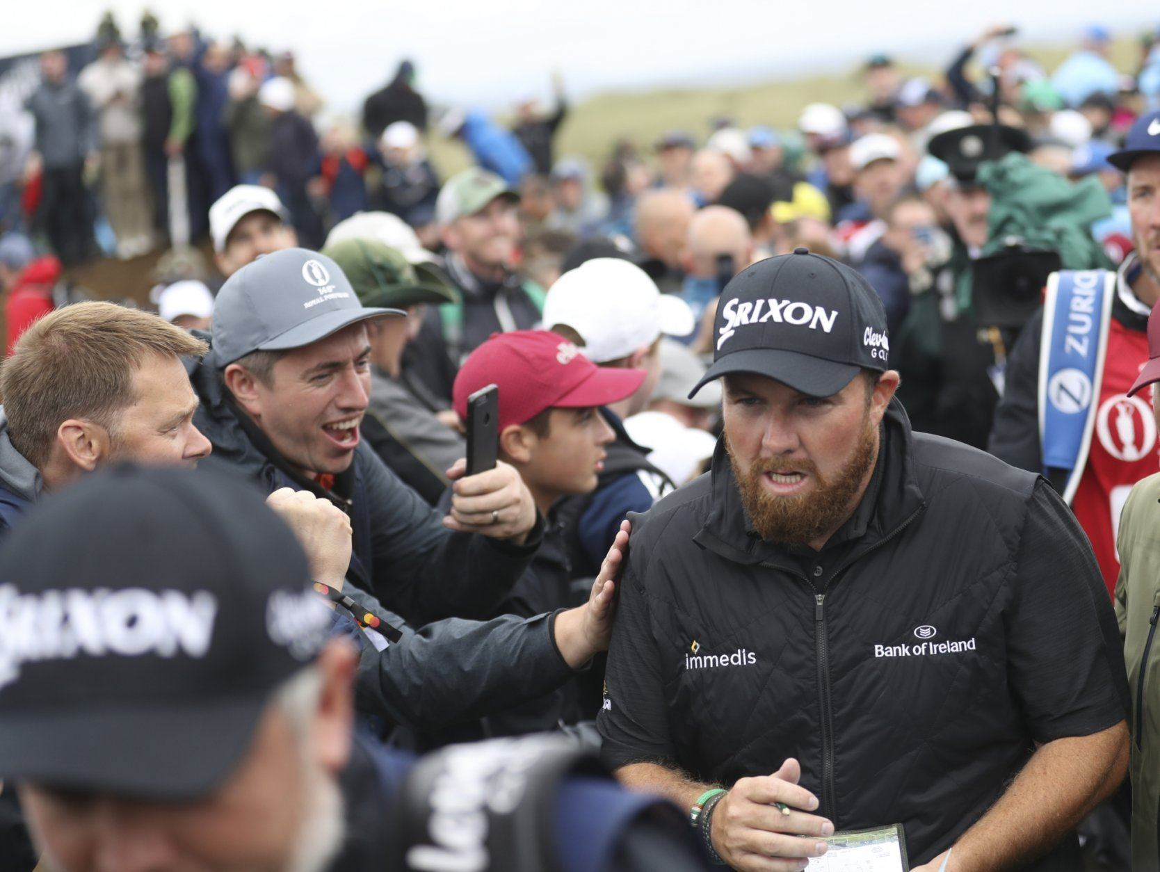 Ireland's Shane Lowry is mobbed by spectators as he walks to the 17th hole during the final round of the British Open Golf Championships at Royal Portrush in Northern Ireland, Sunday, July 21, 2019.(AP Photo/Peter Morrison)