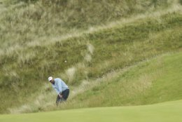 J.B. Holmes of the United States plays out of the rough on 17th hole during the final round of the British Open Golf Championships at Royal Portrush in Northern Ireland, Sunday, July 21, 2019.(AP Photo/Jon Super)