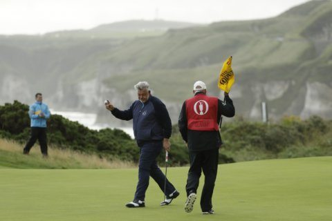 The Latest: McIlroy shoots 79 after wild opening round