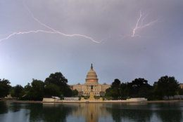 Lightning is seen over the Capitol during a storm on July 6, 2019, in D.C. (WTOP/Dave Dildine)
