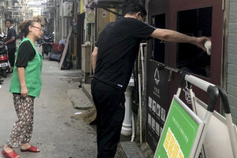 Shanghai tries to reduce its trash, 1 chicken bone at a time