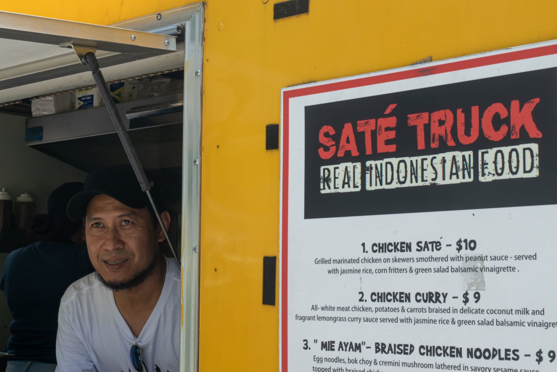 "<p><span style=""font-weight: 400;"">On the corner of 17th and K Streets NW, Sonny Setiantoko fills orders from the window of his food truck for spicy beef curry rendang, corn fritters and braised chicken noodles </span><span style=""font-weight: 400;"">—</span><span style=""font-weight: 400;""> all dishes from his native city of Jakarta. </span></p>"