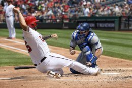 Washington Nationals' Matt Adams, left, is out at the plate against Los Angeles Dodgers catcher Will Smith during the second inning of a baseball game, Sunday, July 28, 2019, in Washington. (AP Photo/Nick Wass)