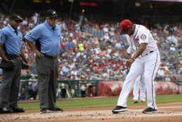 Washington Nationals manager Dave Martinez, right, reacts after he was ejected by home plate umpire Jeremie Rehak, left, during the first inning of a baseball game against the Los Angeles Dodgers, Sunday, July 28, 2019, in Washington. Second base umpire Brian O'Nora, center, looks on. (AP Photo/Nick Wass)