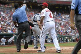 Washington Nationals manager Dave Martinez (4) is ejected by home plate umpire Jeremie Rehak, left, during the first inning of a baseball game against the Los Angeles Dodgers, Sunday, July 28, 2019, in Washington. (AP Photo/Nick Wass)