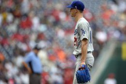 Los Angeles Dodgers starting pitcher Walker Buehler walks toward the dugout after he was pulled from a baseball game during the sixth inning against the Washington Nationals, Sunday, July 28, 2019, in Washington. (AP Photo/Nick Wass)