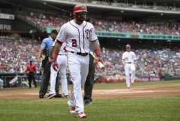 Washington Nationals' Adam Eaton (2) walks to the dugout after he was ejected by home plate umpire Jeremie Rehak, back left, during the first inning of a baseball game against the Los Angeles Dodgers, Sunday, July 28, 2019, in Washington. (AP Photo/Nick Wass)