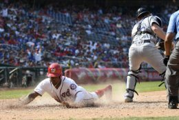 Washington Nationals' Victor Robles, left, slides home to score during the eighth inning of a baseball game past Los Angeles Dodgers catcher Will Smith, right, Sunday, July 28, 2019, in Washington. The Nationals won 11-4. (AP Photo/Nick Wass)