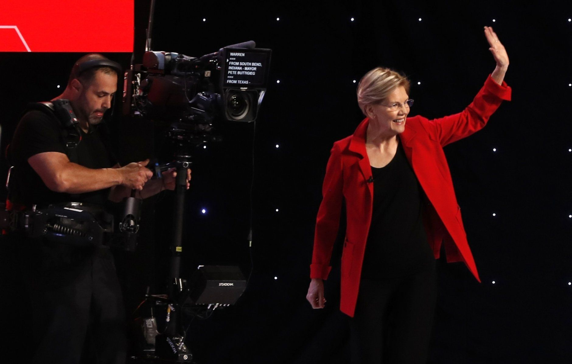 Sen. Elizabeth Warren, D-Mass. takes the stage before the first of two Democratic presidential primary debates hosted by CNN Tuesday, July 30, 2019, in the Fox Theatre in Detroit. (AP Photo/Carlos Osorio)