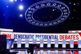 Workers get the stage ready for the Democratic primary debate hosted by CNN Tuesday, July 30, 2019, at the Fox Theatre in Detroit. (AP Photo/Carlos Osorio)