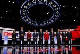 From left, Marianne Williamson, Rep. Tim Ryan, D-Ohio, Sen. Amy Klobuchar, D-Minn., South Bend Mayor Pete Buttigieg, Sen. Bernie Sanders, I-Vt., Sen. Elizabeth Warren, D-Mass., former Texas Rep. Beto O'Rourke, former Colorado Gov. John Hickenlooper, former Maryland Rep. John Delaney and Montana Gov. Steve Bullock take the stage for the first of two Democratic presidential primary debates hosted by CNN Tuesday, July 30, 2019, in the Fox Theatre in Detroit. (AP Photo/Carlos Osorio)