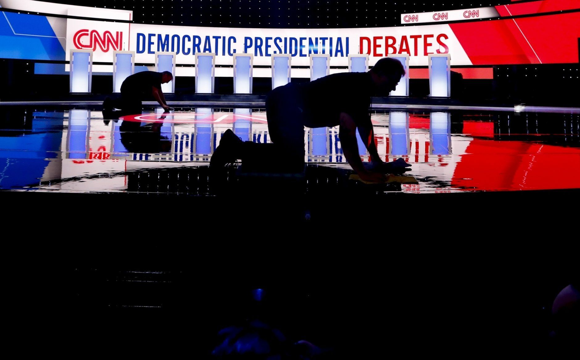 Workers get the stage ready for the Democratic primary debate hosted by CNN Tuesday, July 30, 2019, at the Fox Theatre in Detroit. (AP Photo/Paul Sancya)