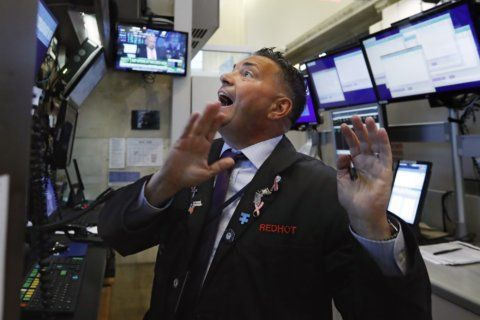 Stocks edge higher in morning trading, narrow weekly losses
