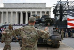 Soldiers with the 3rd Infantry Division, 1st Battalion, 64th Armored Regiment, move a Bradley Fighting Vehicle into place by the Lincoln Memorial, Wednesday, July 3, 2019, in Washington, ahead of planned Fourth of July festivities with President Donald Trump. (AP Photo/Jacquelyn Martin)