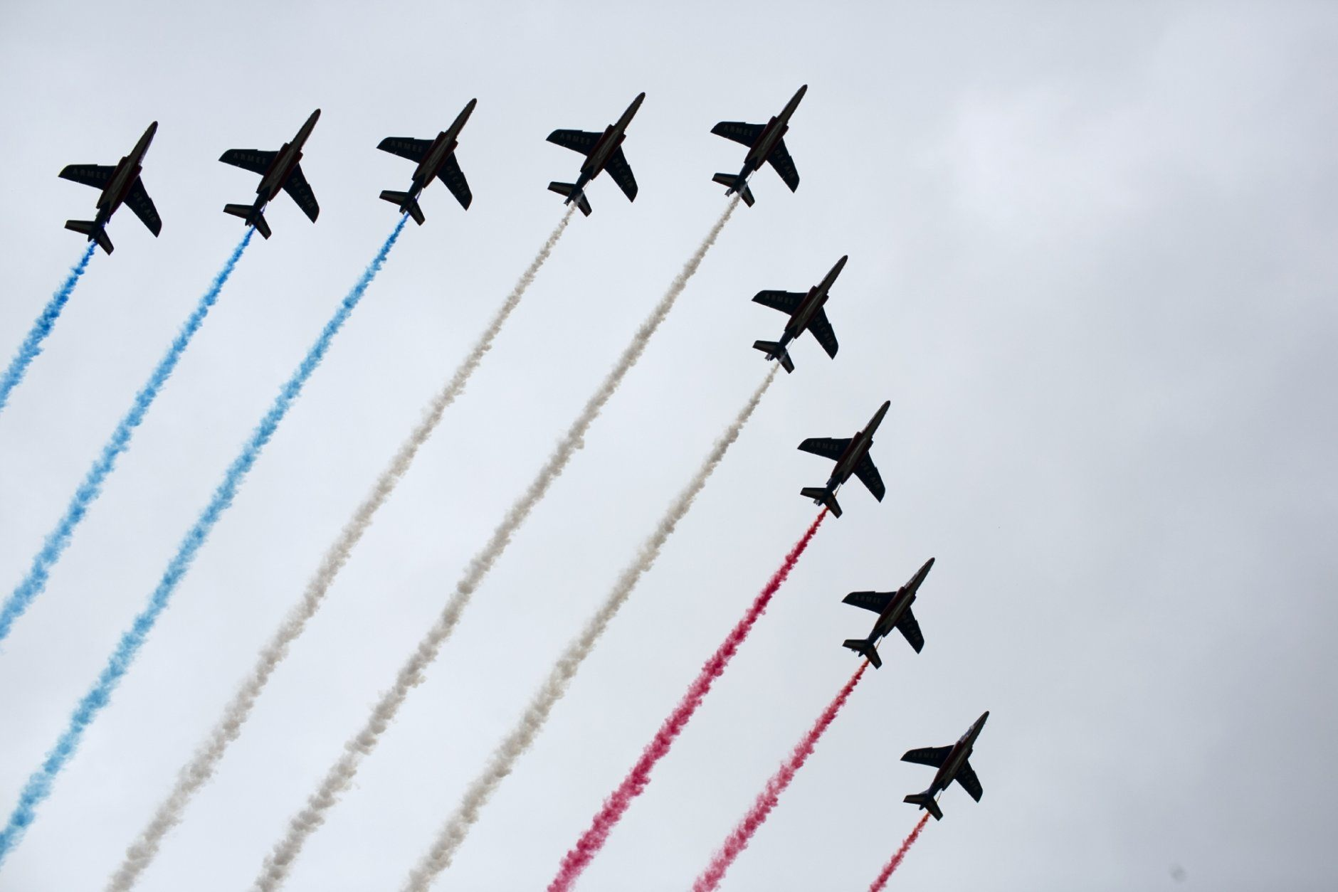 French Alpha jets of the Patrouille de France spray lines of smoke in the colors of the French flag over the Champs-Elysees during Bastille Day parade Sunday, July 14, 2019 near the Champs Elysees avenue in Paris. (AP Photo/Rafael Yaghobzadeh)