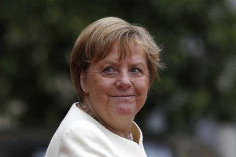 Germany's Merkel sits through anthems again