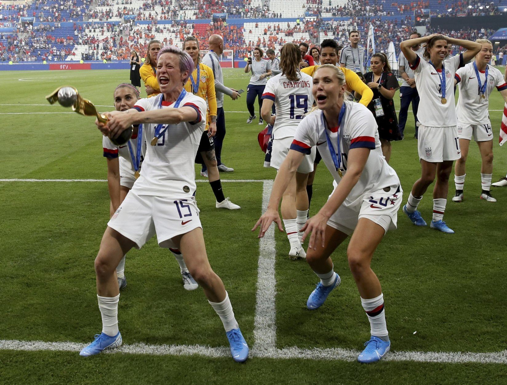 United States' Megan Rapinoe , left, celebrates with teammates their victory in the Women's World Cup final soccer match between US and The Netherlands at the Stade de Lyon in Decines, outside Lyon, France, Sunday, July 7, 2019. US won 2:0. (AP Photo/David Vincent)