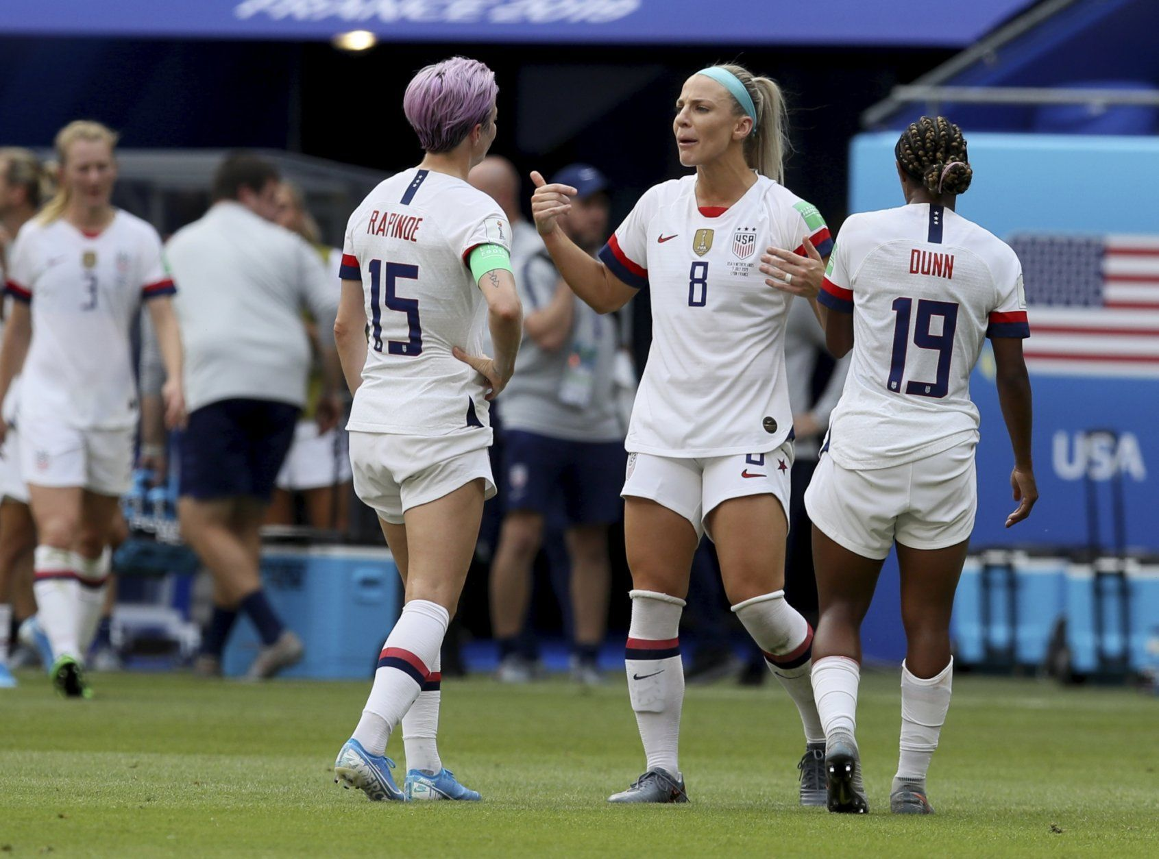 United States' Megan Rapinoe, left, talks to United States' Julie Ertz, center and United States' Crystal Dunn during the Women's World Cup final soccer match between US and The Netherlands at the Stade de Lyon in Decines, outside Lyon, France, Sunday, July 7, 2019. (AP Photo/David Vincent)