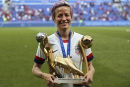 United States' Megan Rapinoe poses with her individual awards at the end of the Women's World Cup final soccer match between US and The Netherlands at the Stade de Lyon in Decines, outside Lyon, France, Sunday, July 7, 2019. The US defeated the Netherlands 2-0. (AP Photo/Francisco Seco)
