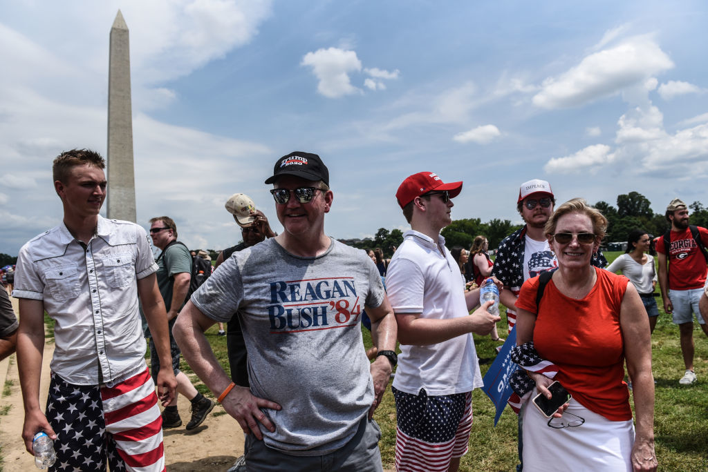 """WASHINGTON, DC - JULY 04: People participate in the Fourth of July festivities on July 4, 2019 in Washington, DC. President Trump is holding a """"Salute to America"""" celebration on the National Mall on Independence Day this year with musical performances, a military flyover, and fireworks. (Photo by Stephanie Keith/Getty Images)"""