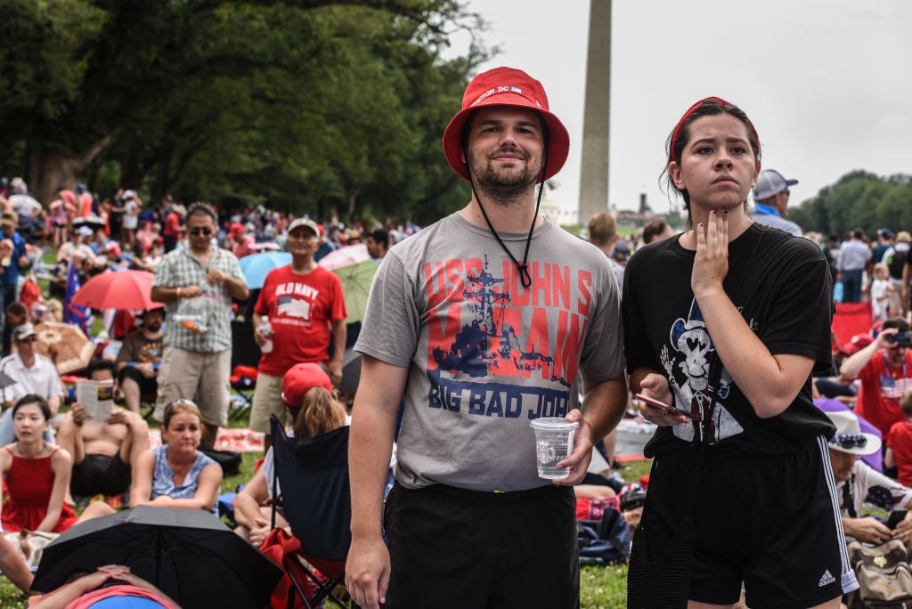 """WASHINGTON, DC - JULY 04: A man wears a USS John S McCain t-shirt on the National Mall ahead of President Trump's speech during Fourth of July festivities on July 4, 2019 in Washington, DC. President Trump is holding a """"Salute to America"""" celebration on the National Mall on Independence Day this year with musical performances, a military flyover, and fireworks. (Photo by Stephanie Keith/Getty Images)"""