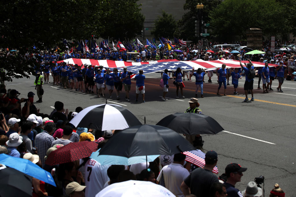 WASHINGTON, DC - JULY 04: Marchers hold a giant U.S. flag as they participate in the National Independence Day Parade July 4, 2019 in Washington, DC. Americans celebrate the nation's 243rd birthday today. (Photo by Alex Wong/Getty Images)