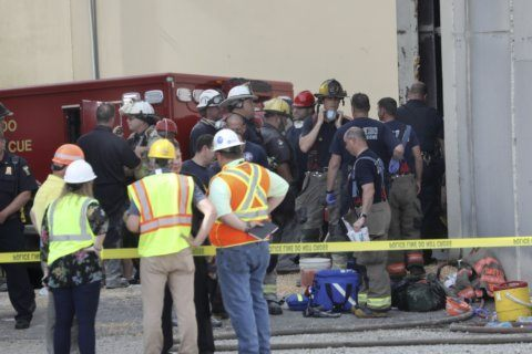 Coroner: 2 workers who died in grain silo suffocated