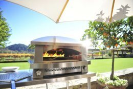 This photo provided by Kalamazoo Outdoor Gourmet shows one of the company's Artisan gas-fired pizza oven at a home in Napa, Calif. Along with a good gas-fired grill, many homeowners are adding a pizza oven to their outdoor cooking area. Pizza ovens can also be used to sear a thick piece of meat or bake items beyond pizza, says La Cuisine Appliances' design director and president Josu Gaubeka. (Kalamazoo Outdoor Gourmet via AP)