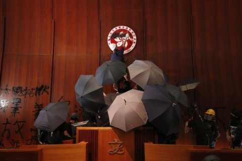 Riot police clear away protesters from Hong Kong legislature