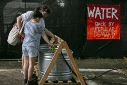 Pitchfork attendees get water at a station during an excessive heat wave in the Chicago area on Saturday, July 20, 2019.