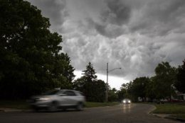 A storm bringing strong winds and a drop in temperature moves in over Flint, Mich., on Saturday, July 20, 2019.