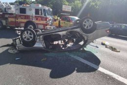 An overturned vehicle delayed rush hour traffic on the Capital Beltway in Bethesda Monday. (Courtesy Pete Piringer)