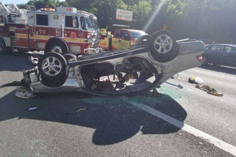 PHOTOS: Overturned vehicle crash jams rush hour Beltway traffic