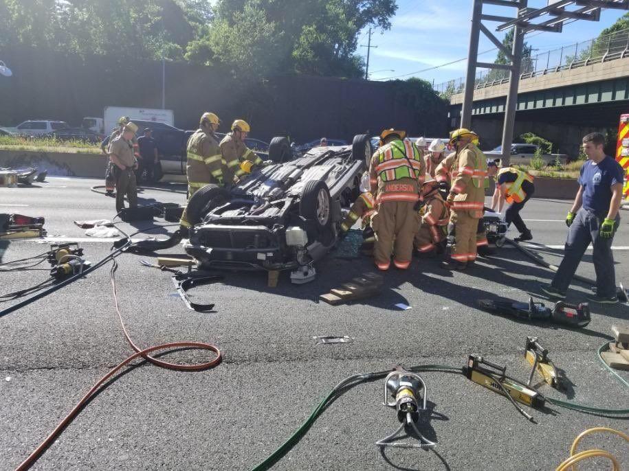 PHOTOS: Overturned vehicle crash jams rush hour Beltway